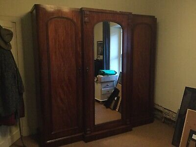 Mahogony Triple Door Linen Press Wardrobe With Central Mirror
