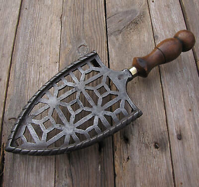 Antique Ornate Cast Iron with Wood and Brass Handle Trivet 19th Century
