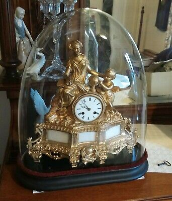 Louis XV French Ormolu Chiming Clock In Dome. In need of service.