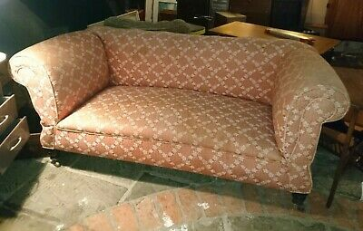 Antique 19th century Chesterfield or Howard and Sons double drop arm sofa.