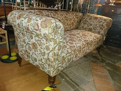 Antique 19th century Chesterfield or Howard and Sons drop arm sofa.