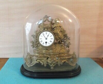 Ormolu Clock. Mid Victorian. Glass dome. Good Condition.