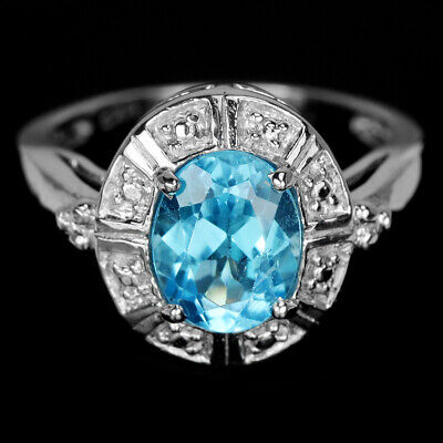 Genuine Swiss Blue Topaz 9X7 Mm. Oval Sterling 925 Silver Solitaire Ring Size 7