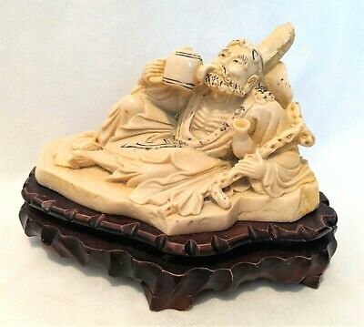 Chinese  Ivory Colored Resin Statue Of Reclining Man Drinking