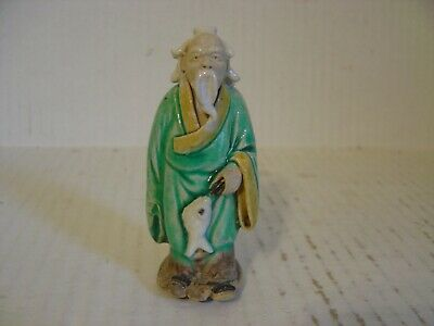 Vintage Chinese Mud Man Porcelain Figurine Of Man In Robe Carrying A Fish 3-3/4""