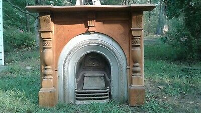 Antique Cast Iron Fireplace Insert with Carved Wooden Surround & Mantle