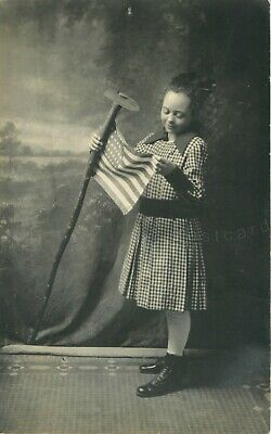 Patriotic Little Girl with US Flag on Rustic Field Hoe RPPC Real Photo Postcard