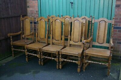A set of eight, solid oak, arts and crafts dining chairs including two carvers