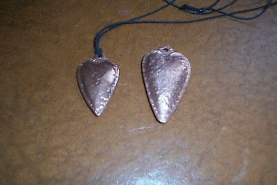 Handmade and beaten copper or brass arts and crafts heart pendants