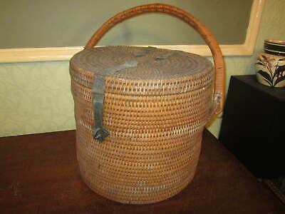 An antique wicker basket with heavy brass fittings - picnic hamper?