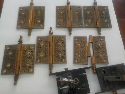 Antique 1873 solid brass door hinges, 2 locks w/key & 2 double light switch plat