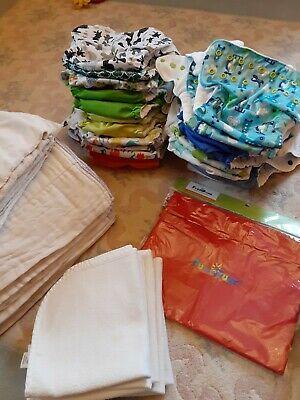 Lot Of 26 Fuzzibunz One Size pocket cloth diapers with extras!