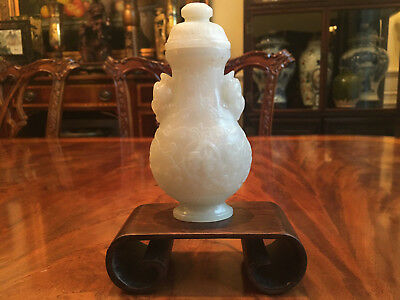 A Fine and Rare Chinese Qing Period Carved Jade Vase with Cover.