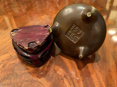 A Chinese Qing Dynasty Bronze Censer with Wooden Stand, Marked.