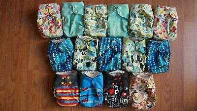 All in one cloth diapers lot of 15 in very used condition, cotton with stay dry