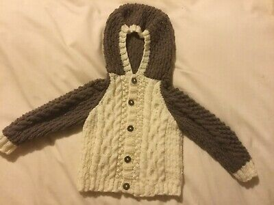 Brand new hand knitted baby Aran  hooded jacket 3-6 months.