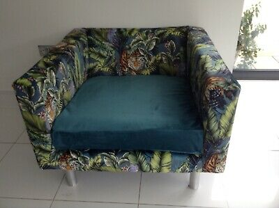 Moooi Lounge Chair upholstered in Prestigious Bengal Tiger Fabric