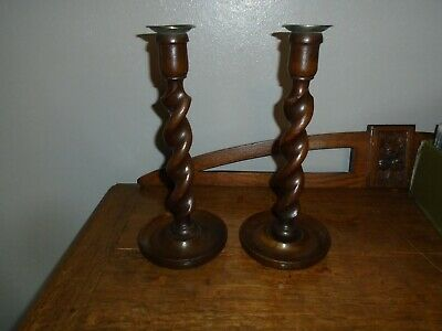 PAIR OF VINTAGE OAK BARLEY TWIST CANDLESTICKS. 12 inches tall.