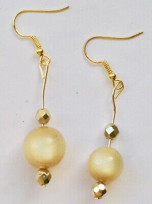 Lovely earrings made of antique yellowish beads with sparkly accents