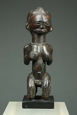 Worn African Kneeling Female Figure with Scarifications