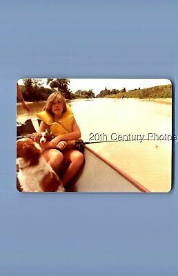 Found Color Photo B_4159 Teen Sitting On Boat Holding Dog And Fishing Pole