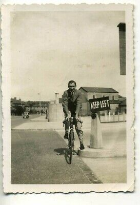 Man Riding a Bicycle Keep Left Sign - Vintage 1930's Fashion Snapshot
