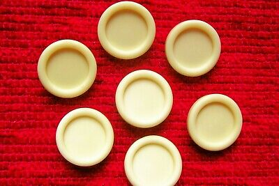 7 vintage 50's cream buttons with a self-shank to back.2 cms. diameter.