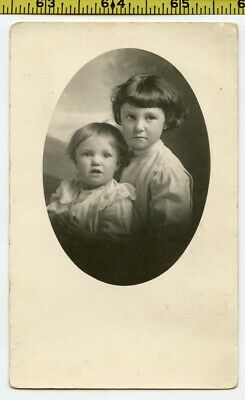 Vintage 1910's RPPC oval photo / Patient Little Girl with Her Ornery Baby Sister