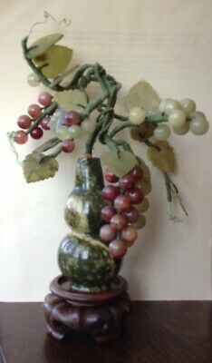 Chinese Carved Hardstone, Jade Coloured Grapevine with leaves on wooden stand.