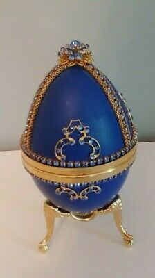 Beautiful Blue Egg Shaped Music Box Adorned with Gold and Crystals