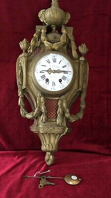 A Large Brass French Striking Cartel Wall Clock