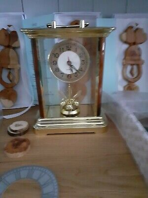 New in box battery operated table /mantle clock with movement