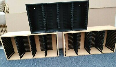 3 X Music CD storage, each holds 60 CD. 2X Beech- 1X Black