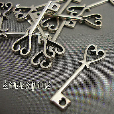 10 Antique Silver Plate Alice in wonderland Key Charms