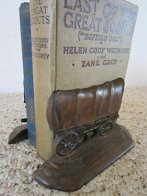 """Vintage Western Cast Iron """"W.h. Howell Co."""" Bookends"""