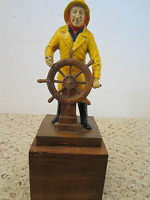 Nautical Old Cast Iron Sculpture Of Fisherman Mounted On Wooden Stand