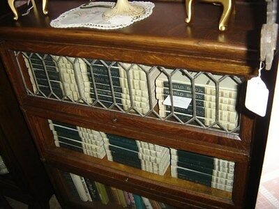 3 Stack Quarter-sawn Oak Barrister Lawyer Bookcase.The top door has leaded glass