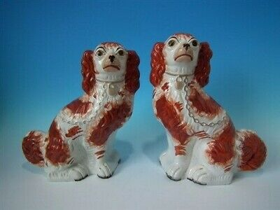 Pair Staffordshire russet & white curly tailed spaniels