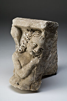 Ancient Roman Marble Sarcophagus Corner Fragment with Eros Ca. 2nd century A.D.