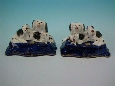 Pair Staffordshire spaniel & pups inkwell