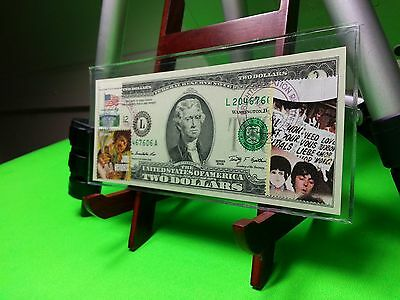Two dollars Uncirculated and paper money and post stamps