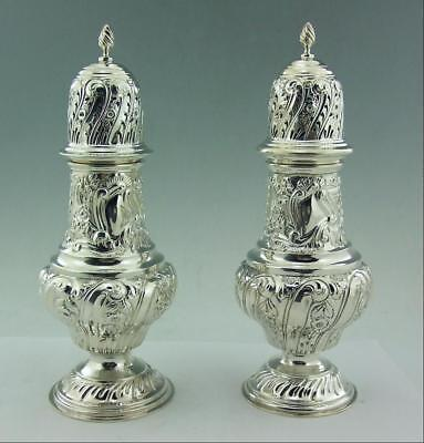 An Impressive Pair Of Large Ornate Edwardian Silver Sugar Casters