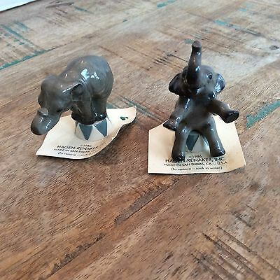 2 retired Hagen Renaker circus elephants with cards