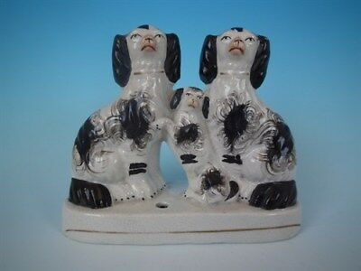 Staffordshire spaniels with pup inkwell
