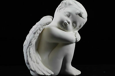 Ready to paint ceramic bisque - Cherub sitting knees up facing right 14 cm tall