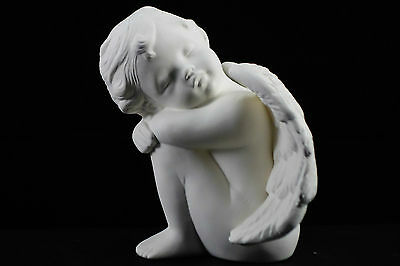 Ready to paint ceramic bisque - Cherub sitting knees up facing left 14 cm tall