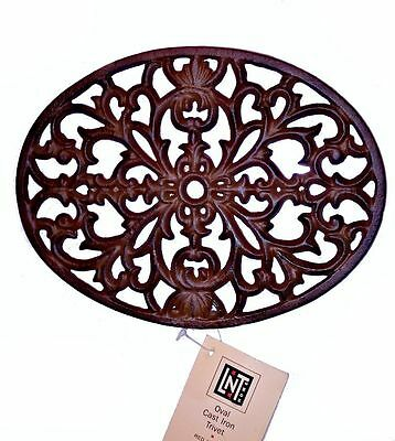 Lot of 4 Cast Iron Footed Trivets