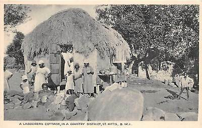 ST KITTS, BWI, COUNTRY DISTRICT, WORKER & FAMILY OUTSIDE THEIR HOME, c. 1907-14