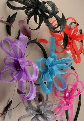 Feather and ribbon hair fascinator on black alice band weddings proms races