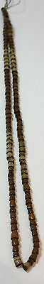 Ancient necklace composed of seed pods, cut in half in brown and white • CAD $49.77